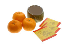 Chinese New Year rice cakes and oranges. Chinese New Year rice cakes, oranges and red packets on white background Stock Photo