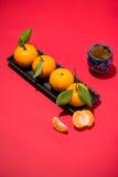 Chinese new year`s decoration. Mandarin orange on red background Stock Photo