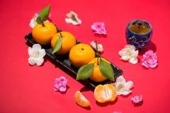 Chinese new year`s decoration. Mandarin orange on red background Royalty Free Stock Photo