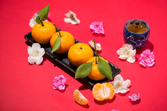Chinese new year`s decoration. Mandarin orange on red background Stock Photography