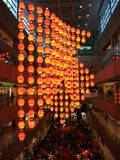 Chinese New Year Sale. Orange lanterns decoration hanging from the ceiling while a sale is going on below for Chinese New Year celebration