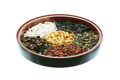 Chinese New Year snacks - assorted seeds and nuts. On white background