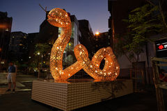 Chinese New Year - The Snake. HAYMARKET, AUSTRALIA - 7 FEBRUARY, 2016; The snake one of the Chinese Zodiac signs street display for Chinese New Year celebrations stock image