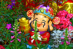 Chinese new year statue holding gold Stock Image