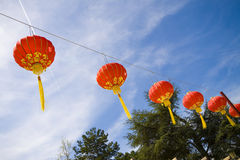 Chinese lanterns in red fabric with golden ornaments. New Year in the streets with many chinese red lanterns Stock Photos