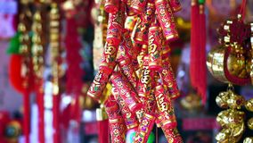 Chinese New Years decorations and fake firecrackers. Words mean best wishes and good luck