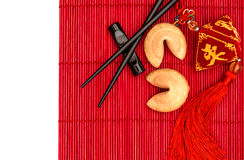 Chinese new years lucky charm, fortune cookies and chopsticks Stock Image
