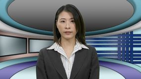 Chinese news anchorwoman in studio. Asian TV News presenter in Television Studio with row of monitors stock video footage