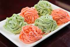 Chinese noodle. Spinach and carrot noodles in the dish Royalty Free Stock Photo