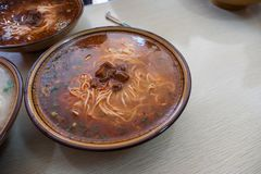 Chinese noodle with beef in spicy soup stock photo