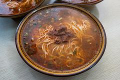 Chinese noodle with beef in spicy soup royalty free stock photo