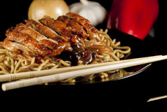 Chinese noodle. With chicken and vegetables on black background royalty free stock images