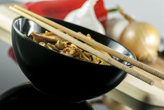 Chinese noodle. With chicken and vegetables on black background stock photos