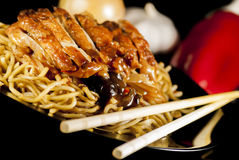 Chinese noodle. With chicken and vegetables on black background royalty free stock photography