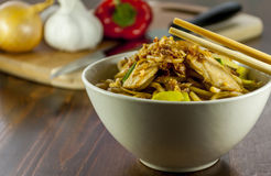 Chinese noodle. With chicken and vegetables on wood table stock images