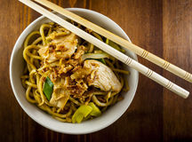 Chinese noodle. With chicken and vegetables on wood table royalty free stock image