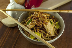 Chinese noodle. With chicken and vegetables on wood table royalty free stock photography