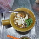 Chinese noodle with fish maw and creamy soup. Chinese noodle. Street food at China town Thailand royalty free stock image