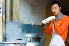 Chinese Noodle Shaving Flying Mid-Air Boiling Pot Stock Images