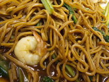 Chinese noodles. Closeup of chinese stir fried noodles with pork, prawn and vegetables. Popular street food dish in Singapore and neighboring countries stock images
