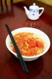 Chinese noodles. This picture was took in a small  restaurant in Beijing China.It is tomato and egg noodles and a vinegar bottle on the background.The vinegar Stock Photos