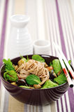 Chinese noodles with basil Stock Images