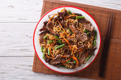 Chinese noodles with beef, muer and vegetables. Horizontal top v Stock Images