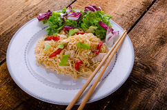 Chinese noodles with chicken and fresh salad Royalty Free Stock Image
