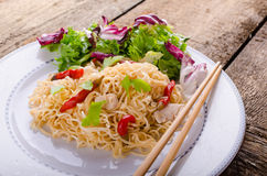 Chinese noodles with chicken and fresh salad Royalty Free Stock Photo