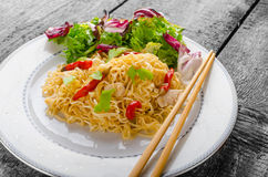 Chinese noodles with chicken and fresh salad Stock Photo
