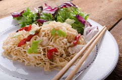 Chinese noodles with chicken and fresh salad Royalty Free Stock Images