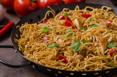 Chinese noodles chicken. Hot peppers and garlic in stock photo