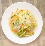 Chinese noodles with cucumber and carrot on a plate close-up stock image
