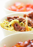 Chinese noodles and fried beef Royalty Free Stock Image