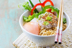 Chinese noodles with minced pork and egg in bowl Royalty Free Stock Photos