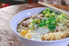 Chinese noodles with minced pork and egg Stock Images