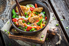 Chinese noodles, vegetables and chicken with sesame Stock Image
