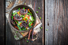 Chinese noodles, vegetables and octopus Stock Photos
