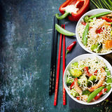 Chinese noodles with vegetables and shrimps Stock Images