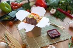 Chinese noodles in wok box. Very delicious and spicy Royalty Free Stock Photo