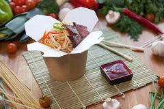 Chinese noodles in wok box. Very delicious and spicy Stock Photo