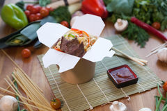 Chinese noodles in wok box. Very delicious and spicy Stock Photography