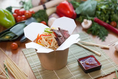 Chinese noodles in wok box. Very delicious and spicy Stock Images