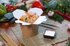 Chinese noodles in wok box. Very delicious and spicy Stock Photos