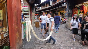 Chinese nougat pulling show on street in old town ,Lijiang China. Royalty Free Stock Photos