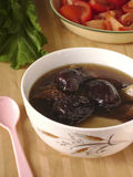 Chinese nourishing red dates soup. Dining Stock Photo
