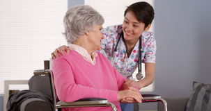 Chinese nurse talking with Senior patient Stock Image