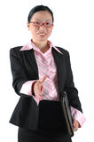 Chinese office lady shaking hands. Asian office lady shaking hands, welcoming. Chinese businesswoman, wearing lady's suit and shirt Royalty Free Stock Images