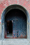 Chinese Old arched door. With red brick Royalty Free Stock Image
