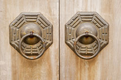Chinese old bronze lock in wooden door. Royalty Free Stock Photos